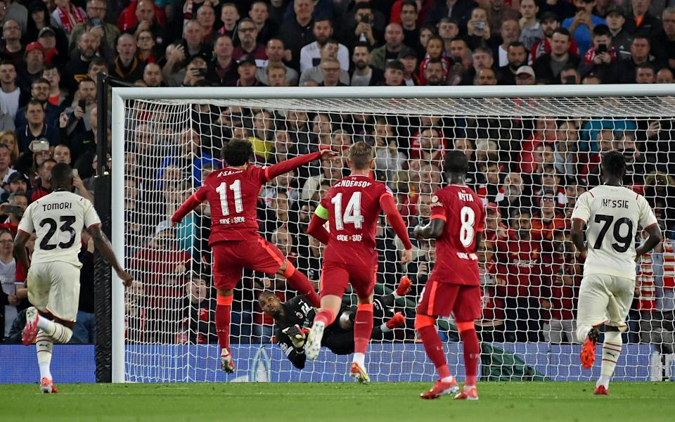 Liverpool's Mohamed Salah has his penalty saved by AC Milan's goalkeeper Mike Maignan during the Champions League Group B soccer match between Liverpool and AC Milan - AP