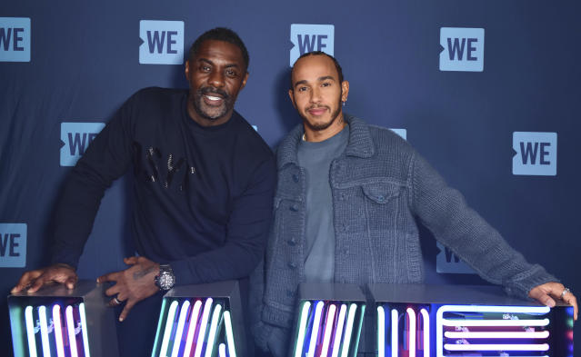 Lewis Hamilton (R) and Idris Elba were together at an event in early March. Elba announced earlier this month that he had tested positive for the coronavirus. (Photo by: KGC-03/STAR MAX/IPx)
