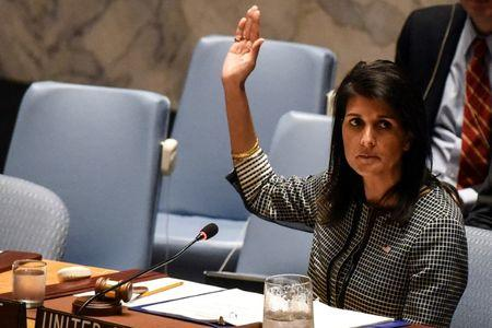 U.S. Ambassador to the U.N. Nikki Haley votes for a draft resolution condemning the reported use of chemical weapons in Syria at the Security Council meeting on the situation in Syria at the United Nations Headquarters in New York