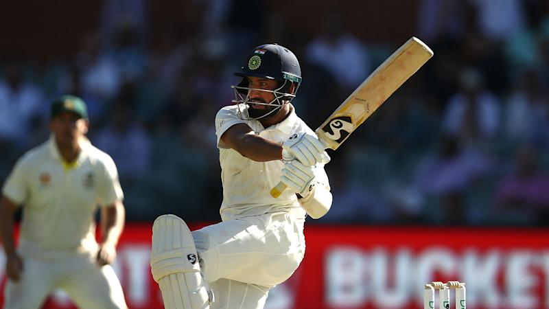 Pujara century rescues India after stunning start from Australia