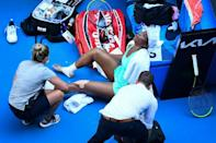 Venus Williams painfully rolled her ankle while playing Italy's Sara Errani