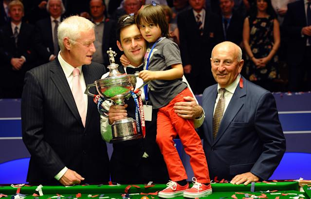 Ronnie O'Sullivan (2nd L)of England and his son Ronnie Jr. celebrate on May 7, 2012 with the chairman of World Snooker, Barry Hearn (L), and sponsor Fred Done (R) after beating Ali Carter of England 18-11 in the World Championship Snooker final at the Crucible Theater in Sheffield, England. AFP PHOTO/PAUL ELLISPAUL ELLIS/AFP/GettyImages