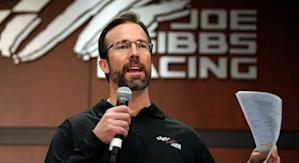 J.D. Gibbs speaks at a team function at Joe Gibbs Racing in 2013