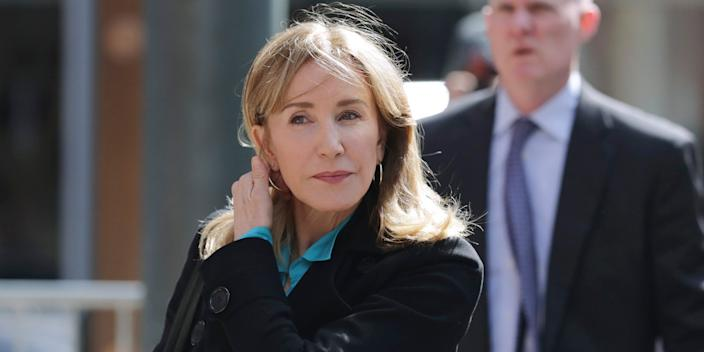 Actress Felicity Huffman arrives at federal court in Boston on Wednesday, April 3, 2019, to face charges in a nationwide college admissions bribery scandal.