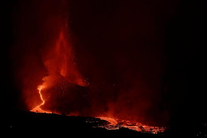Lava spews from a volcano on the Canary island of La Palma, Spain in the early hours of Saturday Sept. 25, 2021. The prompt evacuations are credited with helping avoid casualties but scientists say the lava flows could last for weeks or months.