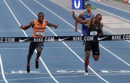 Jun 22, 2018; Des Moines, IA, USA; Noah Lyles (left) defeats Ronnie Baker (center) to win the 100m, 9.88 to 9.90, during the USA Championships at Drake Stadium. Bryce Robinson (right) was seventh in 10.55. Mandatory Credit: Kirby Lee-USA TODAY Sports