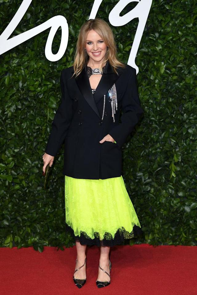 Kylie Minogue was on-trend in a jacket and skirt combo from Christopher Kane [Photo: Getty]