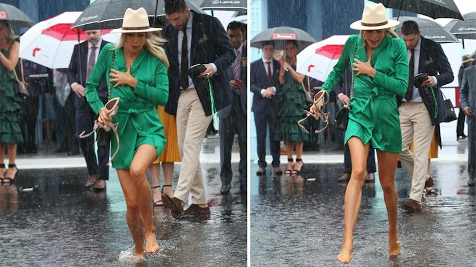 This racegoer was forced to abandon the heels and go barefoot through the pouring rain. Images: AAP