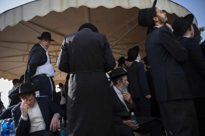 Mourners attend the funeral of Moshe Ben Shalom at a cemetery in Petah Tikva, Israel, Friday, April 30, 2021. Moshe Ben Shalom and several others died and others were injured during a stampede at Lag BaOmer celebrations, a religious festival attended by tens of thousands of ultra-Orthodox Jews in Mt. Meron, northern Israel early Friday. It was one of the country's deadliest civilian disasters (AP Photo/Oded Balilty)