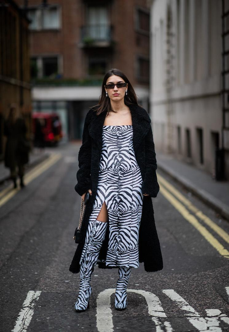 <p>Patricia Manfield was spotted outside the Halpern show in a Zebra thigh-high split dress with matching boots and micro sunnies. <em>[Photo: Getty]</em> </p>