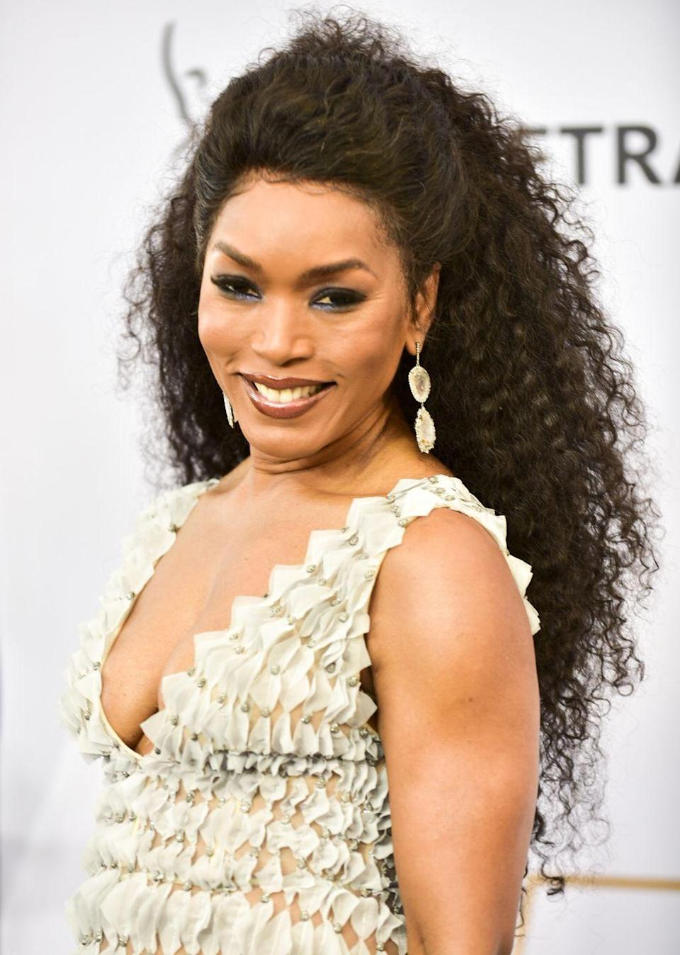 """<p>Angela Bassett signed on to play Brad Pitt's boss in the spy thriller, <em>Mr. & Mrs. Smith</em>. While she filmed her scenes, Bassett's part was cut and <a href=""""https://www.imdb.com/title/tt0356910/trivia"""" rel=""""nofollow noopener"""" target=""""_blank"""" data-ylk=""""slk:she never made it into the final film"""" class=""""link rapid-noclick-resp"""">she never made it into the final film</a>. However, her voice is still heard in the movie.</p>"""