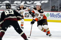 Anaheim Ducks center Trevor Zegras (46) carries the puck in front of Arizona Coyotes defenseman Jordan Oesterle (82) in the first period during an NHL hockey game, Monday, Feb. 22, 2021, in Glendale, Ariz. (AP Photo/Rick Scuteri)