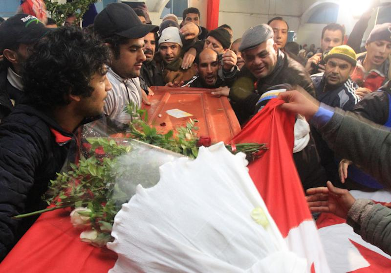Relatives of slain opposition leader Chokri Belaid leave the house of his father while carrying the coffin prior to his funeral in Tunis, Friday, Feb. 8, 2013. Tunisia braced for clashes on Friday, with the capital shut down by a general strike and the army deployed for the funeral of a slain opposition leader expected to draw tens of thousands of mourners, and potentially many more. (AP Photo/Amine Landoulsi)