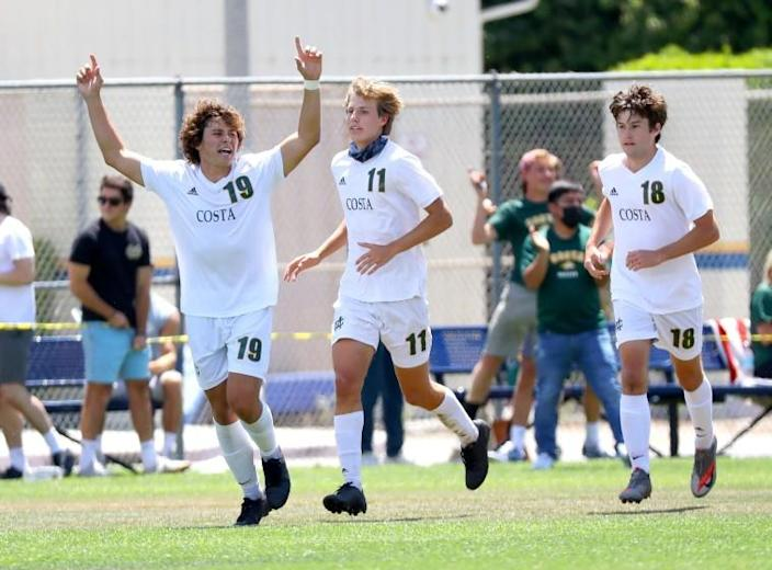 Mira Costa's Thomas Southey (19) celebrates with teammates after scoring against Birmingham on Saturday.