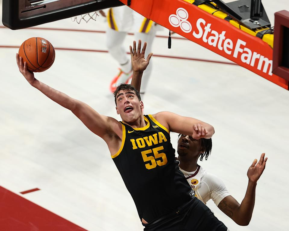 Dec 25, 2020; Minneapolis, Minnesota, USA; Iowa Hawkeyes center Luka Garza (55) shoots the ball during the first half against the Minnesota Gophers at Williams Arena. Mandatory Credit: Harrison Barden-USA TODAY Sports