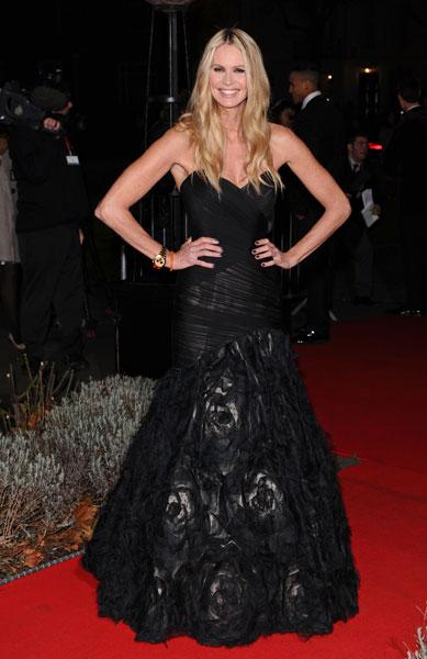 <b>Military Awards red carpet: Elle Macpherson </b><br><br>The Britain and Ireland's Next Top Model judge stole the show in this black gown with rose detail.<br><br>© Rex