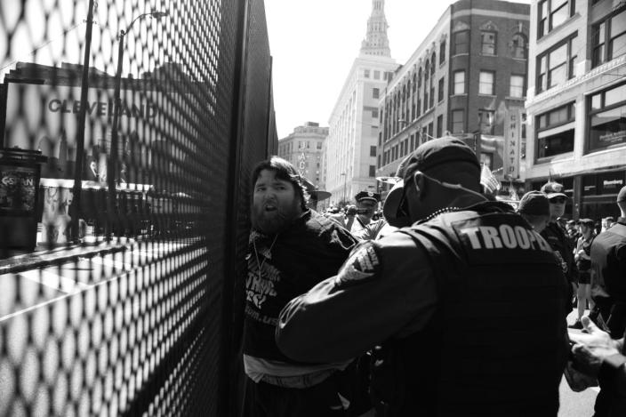 <p>Police detain a protester outside the convention center. (Photo: Khue Bui/Yahoo News)</p>