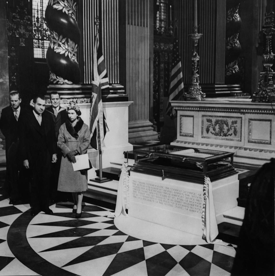 Queen Elizabeth II, with American Vice-President Richard Nixon, and the Duke of Edinburgh, left, after she had unveiled the inscription below the Roll of Honour at the American Memorial Chapel, dedicated in her presence in St. Paul's Cathedral, London.