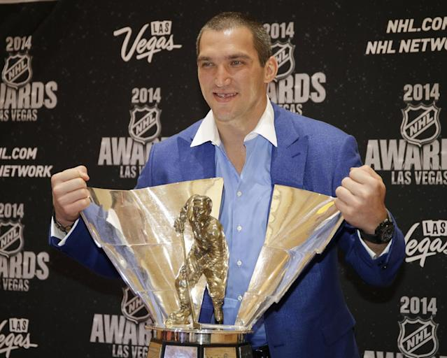 Alex Ovechkin of the Washington Capitals poses with the Richard Trophy after winning the award for top goal-scorer, at the NHL Awards on Tuesday, June 24, 2014, in Las Vegas. (AP Photo/John Locher)