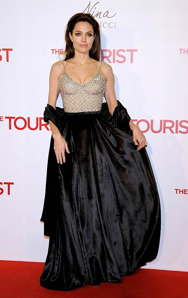 """Last but not least ... Angelina Jolie, who wore a figure skating costume from the waist up and a garbage bag from the waist down to the Spanish premiere of her latest spy flick, """"The Tourist."""" Carlos Alvarez/<a href=""""http://www.gettyimages.com/"""" target=""""new"""">GettyImages.com</a> - December 16, 2010"""