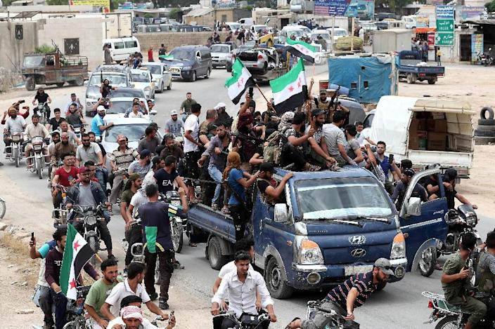 Syrian rebel fighters were among the mourners at his funeral (AFP Photo/OMAR HAJ KADOUR)