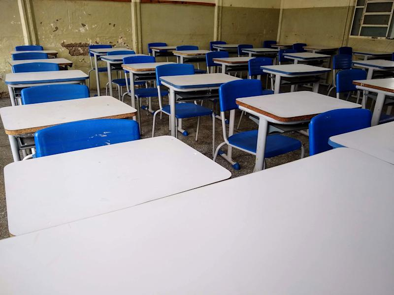 Classroom desks lined up ready to start classes at a school in Brazil.