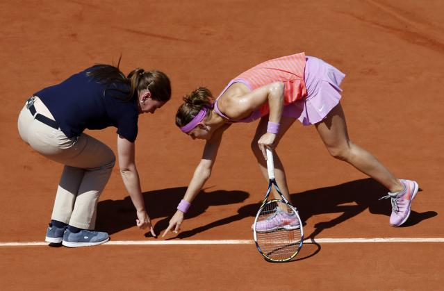 Lucie Safarova of the Czech Republic argues with a referee during her women's semi-final match against Ana Ivanovic of Serbia at the French Open tennis tournament at the Roland Garros stadium in Paris, France, June 4, 2015. REUTERS/Jean-Paul Pelissier