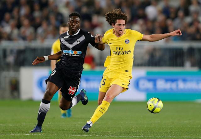 Soccer Football - Ligue 1 - Bordeaux v Paris St Germain - Matmut Atlantique, Bordeaux, France - April 22, 2018 Paris Saint-Germain's Adrien Rabiot in action with Bordeaux's Soualiho Meite REUTERS/Regis Duvignau