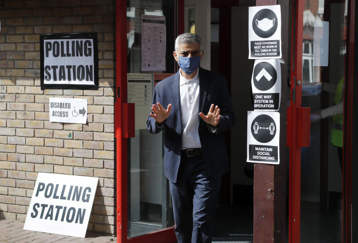 Mayor of London Sadiq Khan leaves the polling station, at St Albans Church in London, Thursday, May 6, 2021. Millions of people across Britain will cast a ballot on Thursday, in local elections, the biggest set of votes since the 2019 general election. A Westminster special-election is also taking place in Hartlepool, England. (AP Photo/Frank Augstein)