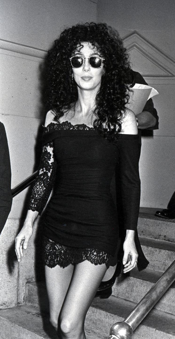 """<p>In a lace off-the-shoulder little black dress and sunglasses at a press conference for her """"Uninhibited"""" fragrance. </p>"""