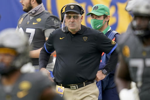 FILE - Pittsburgh head coach Pat Narduzzi wears a face shield as he watches his team play against Notre Dame during the first half of an NCAA college football game, Saturday, Oct. 24, 2020, in Pittsburgh. Narduzzi says Georgia Tech quarterback Jeff Sims' growth in making decisions is impressive for a freshman. Pitt's fierce pass rush will be a new test for Sims' ability to remain poised in the pocket on Saturday night. (AP Photo/Keith Srakocic, File)