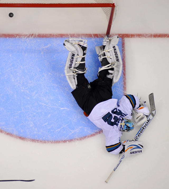 San Jose Sharks goalie Alex Stalock is scored on by Los Angeles Kings center Anze Kopitar, of Slovenia, during the third period in Game 6 of an NHL hockey first-round playoff series, Monday, April 28, 2014, in Los Angeles. The Kings won 4-1. (AP Photo)