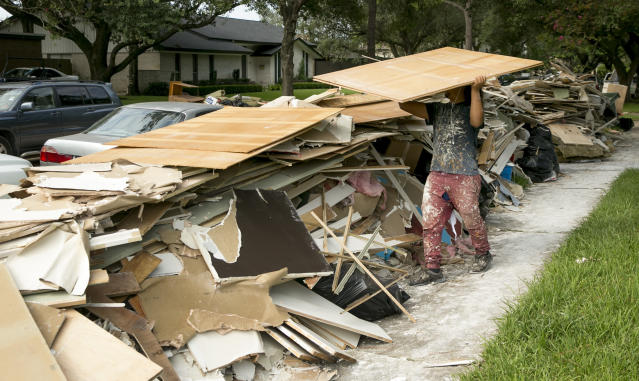 <p>Miguel Moncado, of Oxford Contractors, guts a flood-damaged home in the Meyerland neighborhood in Houston after Hurricane Harvey on Friday Sept, 1, 2017. (Photo: Jay Janner/Austin American-Statesman via AP) </p>