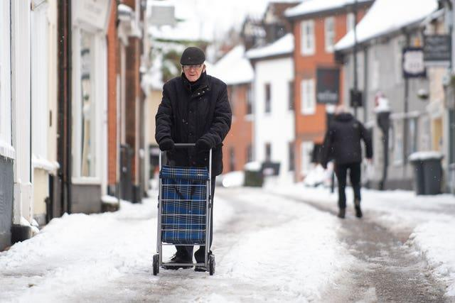 A man pushes his trolley through Woodbridge in Suffolk