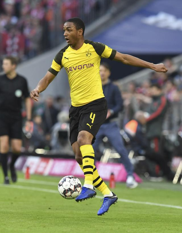 FILE - In this Saturday, April 6, 2019 file photo Dortmund's Abdou Diallo controls the ball during the German Bundesliga soccer match between FC Bayern Munich and Borussia Dortmund in the Allianz Arena in Munich, Germany. (AP Photo/Kerstin Joensson, File)