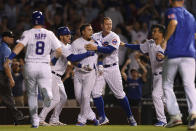 Chicago Cubs' Javier Baez center, celebrates with teammates after hitting a walk-off single in the ninth inning to defeat the Cincinnati Reds 6-5 in a baseball game Monday, July 26, 2021, in Chicago. (AP Photo/Paul Beaty)