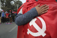 Nepalese protesters of the splinter group in the governing Nepal Communist Party participate sing Nepalese national anthem during a protest in Kathmandu, Nepal, Friday, Jan. 22, 2021. Thousands of demonstrators rallied in Nepal's capital Friday protesting against the prime minister who had dissolved the parliament and ordered fresh election because of feuds within the ruling political party. (AP Photo/Niranjan Shrestha)