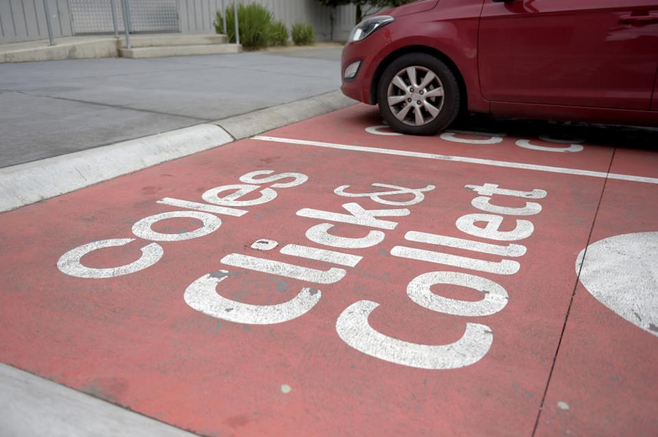 A vehicle sits in the click-and-collect service area outside a Coles Supermarket.