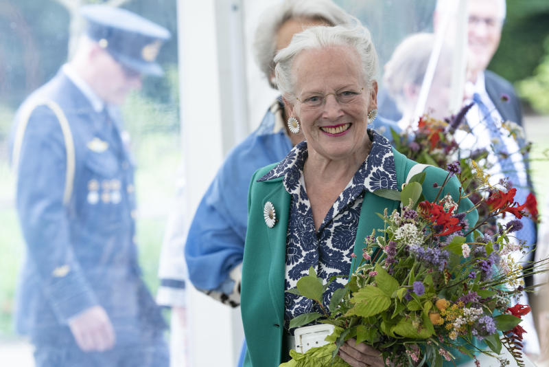 """Queen Margrethe II of Denmark smiles as she opens the royal kitchen garden at Graasten Castle in Southern Jutland, July 24, 2020. - The """"Royal Kitchen Garden"""" will be a new, regional tourist attraction in Southern Jutland, which will also be a local gathering place for teaching and activities that connect for sustainable cultivation of herbs, vegetables, berries and fruit."""