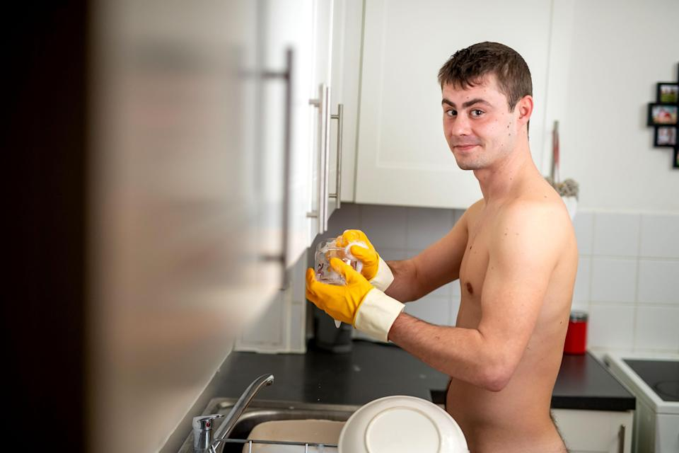 A young man has decided to bare all to become a naked cleaner – and he says business is booming. Photo: Caters News