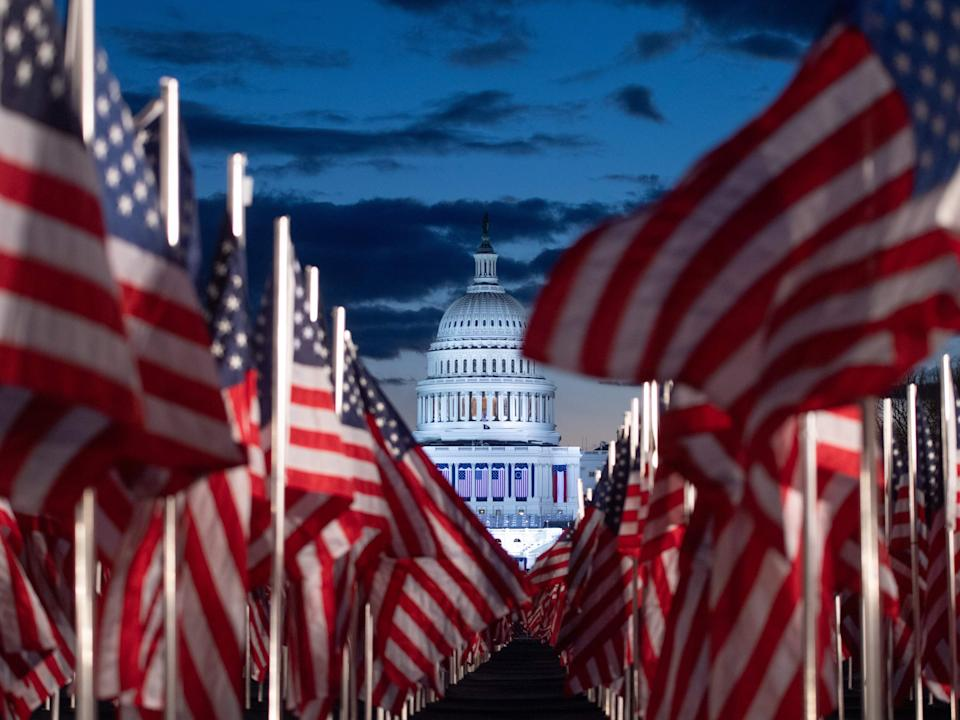 Nearly 200,000 American flags are seen in the early hours of Inauguration Day on the National Mall as part of a 'Field of Flags' exhibition to represent those not able to attend due to the Covid-19 pandemicAFP via Getty Images