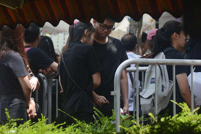Members of the public lining up at Singapore actor Aloysius Pang's public memorial in Singapore Saturday, Jan. 26, 2019. Pang died from injuries sustained during a military training exercise in New Zealand on Thursday. (AP Photo/Annabelle Liang)