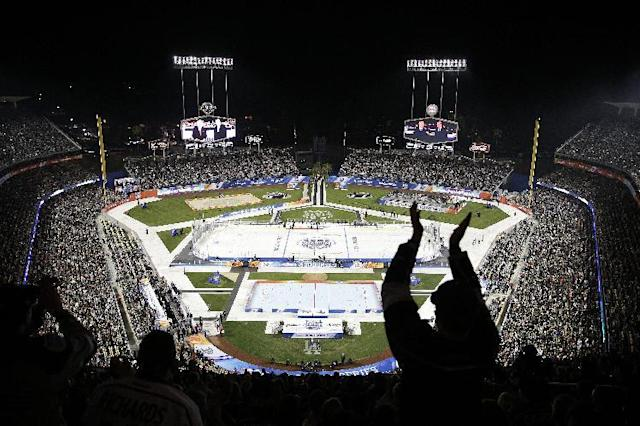 The fans cheer before an NHL outdoor hockey game between the Los Angeles Kings and the Anaheim Ducks at Dodger Stadium on Saturday, Jan. 25, 2014, in Los Angeles. (AP Photo/Jae C. Hong)