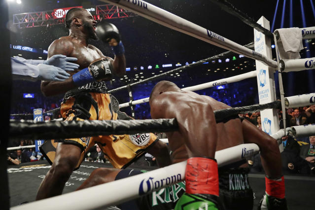 FILE - In this March 3, 2018, file photo, Deontay Wilder celebrates after knocking down Luis Ortiz during the sixth round of a WBC heavyweight championship boxing bout in New York. Deontay Wilder is awkward but dangerous, a string bean of a heavyweight with a crushing right hand that can change everything in a fraction of a second. Luis Ortiz is a big puncher, too, though there are questions about both his stamina and age going into Saturdays rematch with Wilder that serves as an appetizer for what comes next. (AP Photo/Frank Franklin II, File)