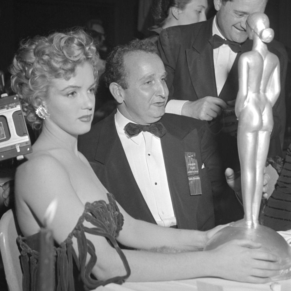 <p>Holding her first of many 'Henrietta' statuettes at the Foreign Press Association of Hollywood's First Annual International Film Festival on January 26. </p>