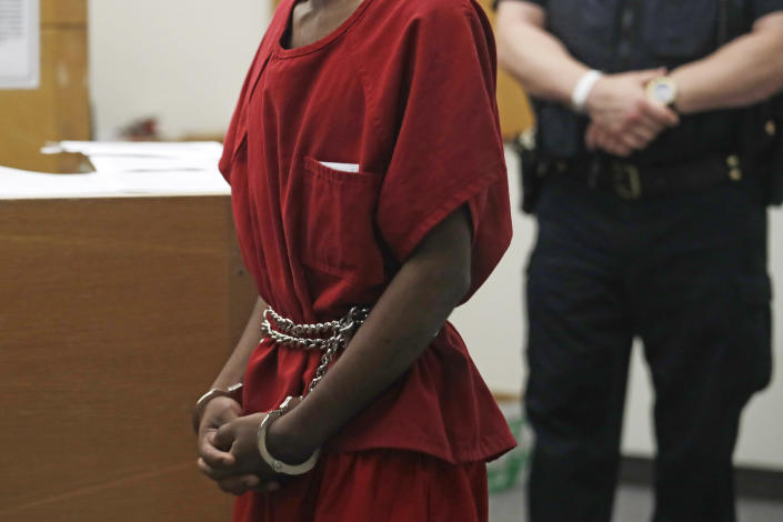 Dawit Kelete wears handcuffs chained to his waist as he walks into a court appearance Monday, July 6, 2020, in Seattle. Kelete is accused of driving a car on to a closed Seattle freeway and hitting two protesters, killing one, over the weekend. Seattle has been the site of prolonged unrest over the death of George Floyd, a Black man who was in police custody in Minneapolis. (AP Photo/Elaine Thompson)