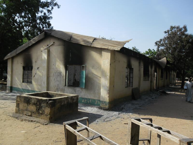 Burnt out school block following a gun battle and explosions by the Boko Haram sect in Potiskum, Nigeria, Saturday, Oct. 20 , 2012. A Chinese construction worker has been killed in a besieged city in Nigeria's northeast, an official said Friday, exacerbating security concerns for foreign workers in Nigeria's violence-wracked northeast, while an overnight raid in a nearby city left 5 others dead and several schools razed to the ground. (AP Photo/Adamu Adamu)