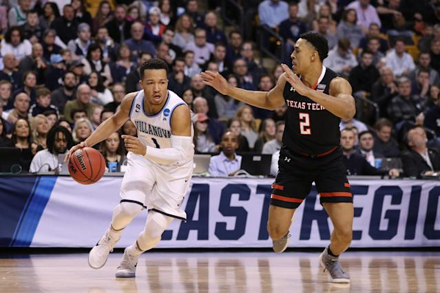 Villanova's Jalen Brunson drives on Texas Tech's Zhaire Smith during Sunday's Elite Eight game in Boston. (Getty)
