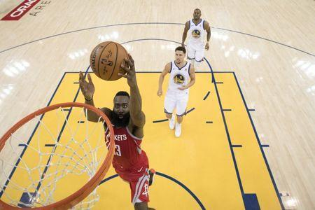 May 20, 2018; Oakland, CA, USA; Houston Rockets guard James Harden (13) shoots the basketball against Golden State Warriors guard Klay Thompson (11) and forward Andre Iguodala (9) during the second half in game three of the Western conference finals of the 2018 NBA Playoffs at Oracle Arena. The Warriors defeated the Rockets 126-85. Mandatory Credit: Kyle Terada-USA TODAY Sports