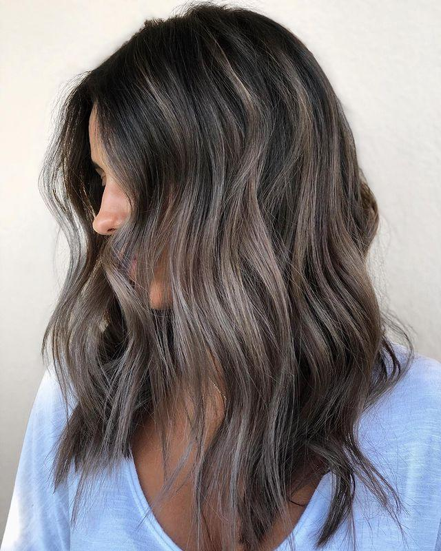 """<p>Fact: <strong>Dark, brown-black roots are a great way to complement some of the lighter tones</strong> in your ash-brown <a href=""""https://www.cosmopolitan.com/style-beauty/g9916693/best-summer-hair-colors/"""" rel=""""nofollow noopener"""" target=""""_blank"""" data-ylk=""""slk:hair color."""" class=""""link rapid-noclick-resp"""">hair color.</a> I love how the highlights are kinda piece-y in this look—it's such a pretty contrast. </p><p><a href=""""https://www.instagram.com/p/B1ocFBHJrdg/"""" rel=""""nofollow noopener"""" target=""""_blank"""" data-ylk=""""slk:See the original post on Instagram"""" class=""""link rapid-noclick-resp"""">See the original post on Instagram</a></p>"""